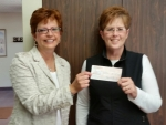 Stewardship Minister Julie Henry and Lunch Bag Coordinator Debby Pazehoski accept donation check from Stewartsville Lions