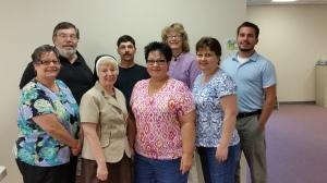 (L-R)Cathy, Father Len, Sister Charlene, Shon, Diana, Marion, Roseann, John. (photo credit-Julie)